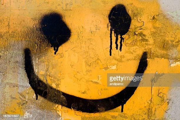 spraypainted smiley face