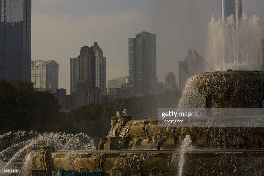 Sprays of water shoot into the air at the Clarence Buckingham Fountain in Grant Park as seen in this 2009 Chicago Illinois late afternoon cityscape...