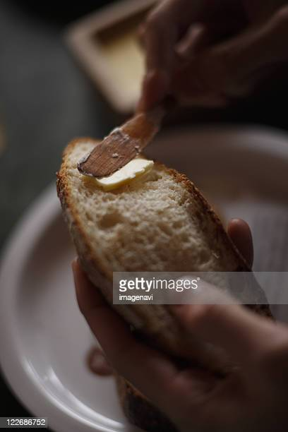 Spreading bread with butter