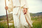 Shot of Jesus walking alone in the wilderness