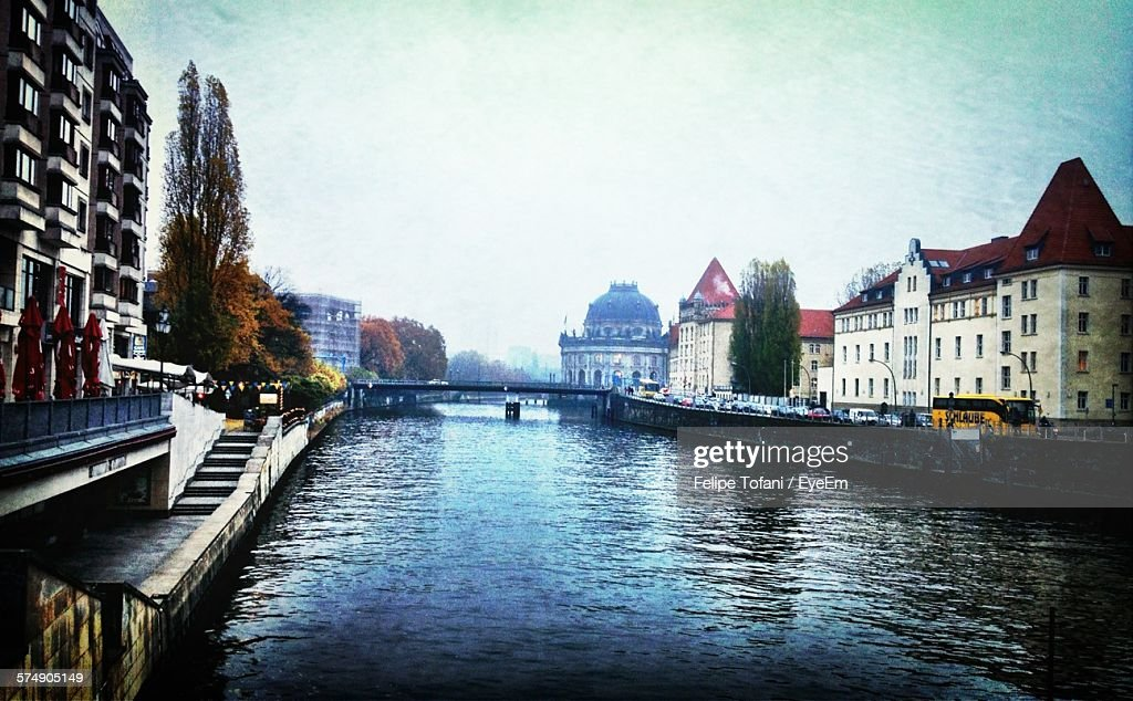 Spree River Amidst Buildings During Foggy Weather