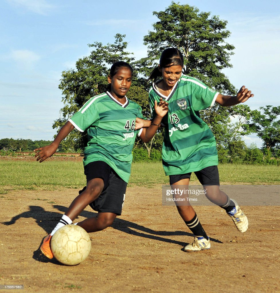 Spriha Kumari (R) of the Yuwa Football Academy during the practice session at Hutap village on August 2, 2013 in Ranchi, India. On July 13, the 18 tribal girls representing Yuwa India under-14 all-girls team were placed third among 10 teams playing for the Gasteiz Cup in Victoria Gasteiz in Spain. In 2012, Yuwa became the first organisation in India to win the Nike Gamechangers Award. Yuwa also won the NDTV Spirit of Sports Award, Times Now Amazing Indians Award. Set up in 2009 by Franz Gastler, its an NGO that uses football to combat child marriage and human trafficking in Jharkhands tribal belt. Gastler, a US citizen, started as an English teacher for underprivileged children when he was requested by the girls to teach them football. He formed Yuwa India, a U-14 side with girls from local villages. Having started with 15 girls in 2009, Yuwa now has over 200 aspiring footballers. The Jharkhand government has announced it would build a stateof-the-art stadium on five acres of land for the Yuwa girls. Chief Minister Hemant Soren also announced cash awards of Rs 21,000 to each of the 18 girls who were in the squad. The Yuwa team would be felicitated by the state government on August 29, the National Sports Day.