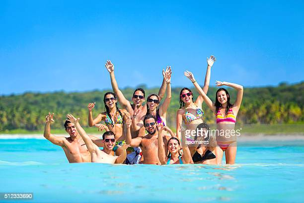 Spring break group of young people having fun tropical beach