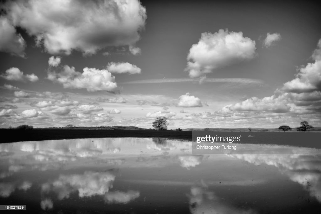 . Spring clouds are reflected in a puddle in a field in the West Yorkshire countryside on April 11, 2014 in Eccup, United Kingdom.