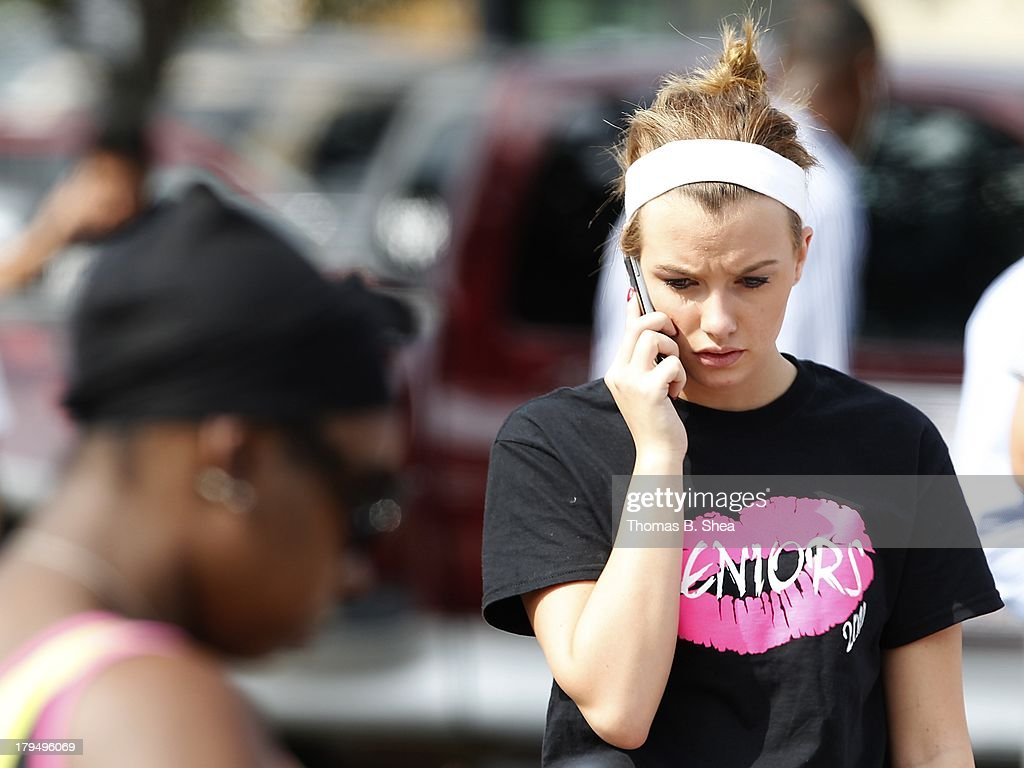 Spring High School Senior Amanda Hasty tries to call her parents after a stabbing at Spring High School September 4, 2013 in Spring, Texas. A 17-year-old student was fatally stabbed and three other students during what has been reported as a fight at the school about 7:00 am. Three people have been taken into custody.