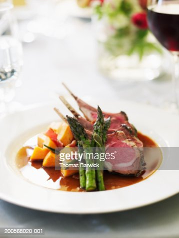 Spring lamb chops with asparagus and yams with bacon and sage : Stock Photo