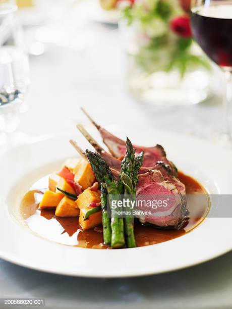 Spring lamb chops with asparagus and yams with bacon and sage