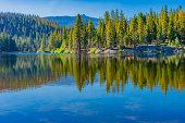 Water reflection; mountain lake; resort life; quite getaway; mountain recreation; peaceful morning; relaxing location