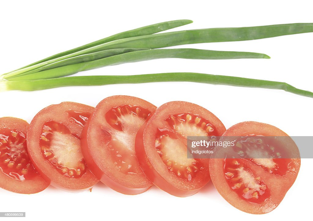 Spring onions and sliced tomatoes. : Stock Photo