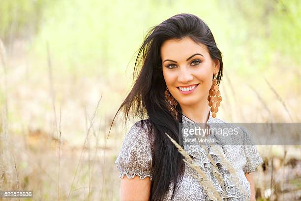 Spring portrait of beautiful elegant woman in nature