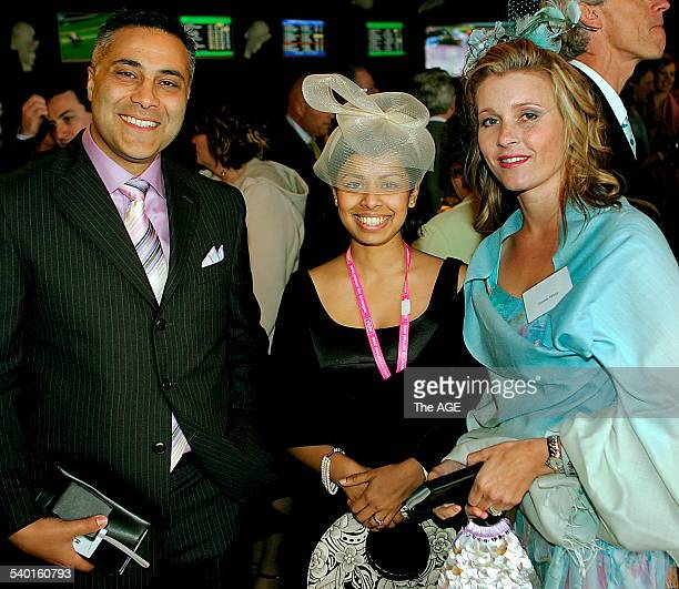 Spring Racing Carnival 2006 Age journalist Nabila Ahmed centre with Ahmed Fahour and his wife Dionnie at the 2006 Melbourne Cup at Flemington...