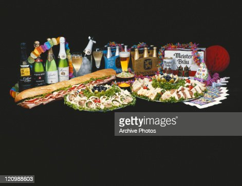 Spring rolls, sandwiched and various champagne bottle on black background