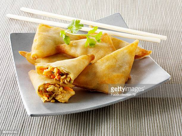 Spring rolls with chopsticks, close up