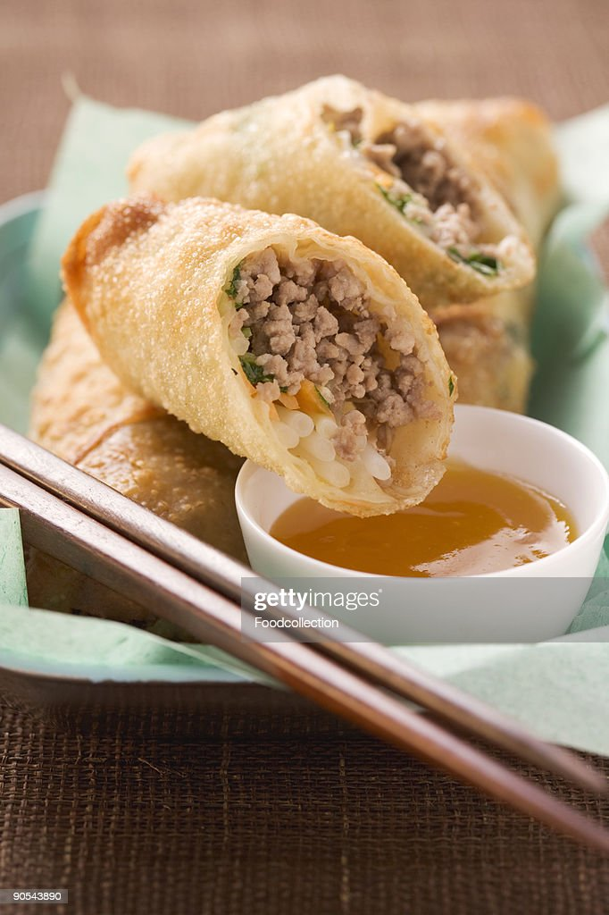 Spring rolls with mince filling and dip, close up : Stock Photo