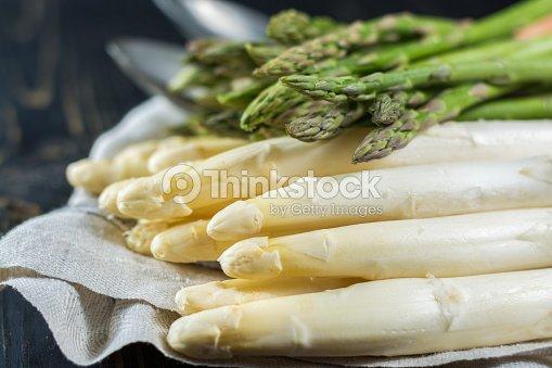 Spring season - fresh white and green uncooked asparagus : Stock Photo