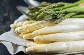 Spring season - fresh white and green asparagus on linen napkin