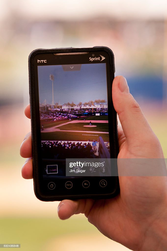 Spring Training Baseball 2012a game between the San Francisco Giants and the Milwaukee Brewers at Maryvale Arizona Fan takes a photo of the Maryvale...