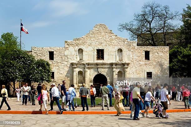Spring vacation with lots of tourists walking around historic Alamo San Antonio Texas United States