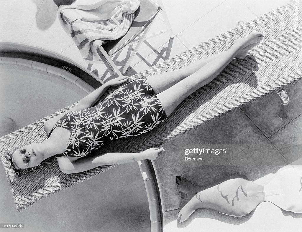 A springboard proves it has more uses than aiding divers gain form in plunging into a pool Lovely Bette Davis Warner Bros star uses it to relax and...