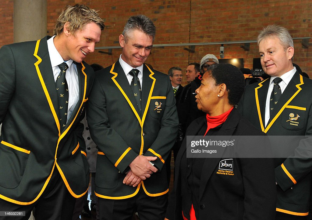 Springbok captain Jean de Villiers and Coach <a gi-track='captionPersonalityLinkClicked' href=/galleries/search?phrase=Heyneke+Meyer&family=editorial&specificpeople=630057 ng-click='$event.stopPropagation()'>Heyneke Meyer</a> with Antoinette Sithole and Ian Schwartz during a wreath-laying ceremony at the Hector Pieterson Memorial on June 14, 2012 in Soweto, South Africa.