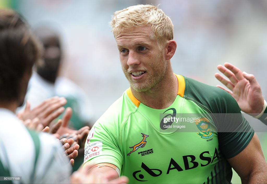 Springbok captain, <a gi-track='captionPersonalityLinkClicked' href=/galleries/search?phrase=Kyle+Brown+-+Rugby+Player&family=editorial&specificpeople=5870383 ng-click='$event.stopPropagation()'>Kyle Brown</a> of South Africa is congratulated on his 50th tournament after day 1, match 8 of the HSBC Cape Town Sevens in the game between South Africa and Zimbabwe at Cape Town Stadium on December 12, 2015 in Cape Town, South Africa.