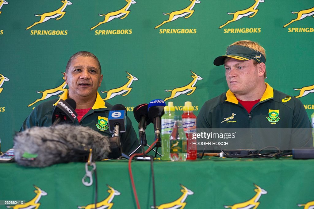 Springbok coach Alister Coetzee (L) announces that South-African lock Adriaan Strauss (R) will be the Springbok's 57th captain, after a training session in Stellenbosch, on May 30, 2016. / AFP / RODGER