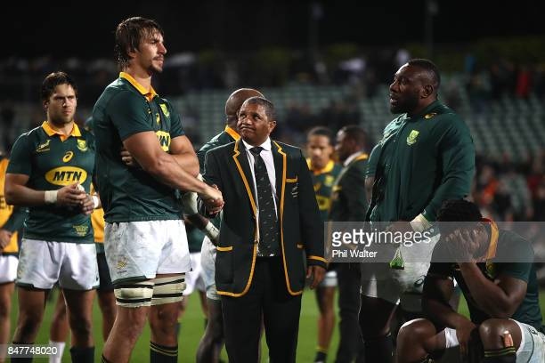 Springbok coach Alister Coetzee shakes hands with captain Eben Etzebeth following the Rugby Championship match between the New Zealand All Blacks and...