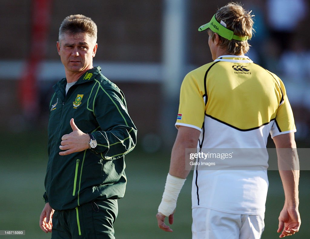 Springbok coach <a gi-track='captionPersonalityLinkClicked' href=/galleries/search?phrase=Heyneke+Meyer&family=editorial&specificpeople=630057 ng-click='$event.stopPropagation()'>Heyneke Meyer</a> with Jean de Villiers during the South African national rugby team training session at Northwood Crusaders Rugby Club on June 04, 2012 in Durban, South Africa.
