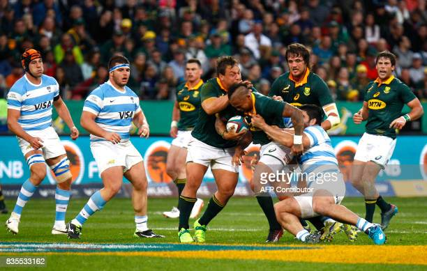 Springboks flyhalf Elton Jantjies is tackled during the International Rugby Test match between Argentina and South Africa at The Nelson Mandela Bay...