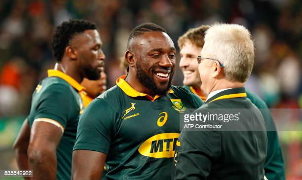 Springboks loose head forward Tendai Mtawarira celebrates with team management after victory in the International Rugby Championship Test match...