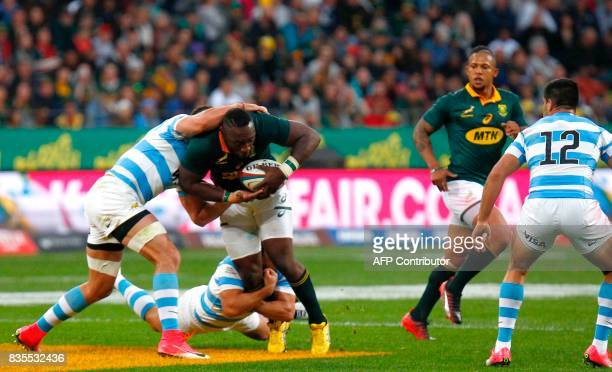 Springboks loose head prop forward Tendai Mtawarira is tackled during the International Rugby Test match between Argentina and South Africa at The...