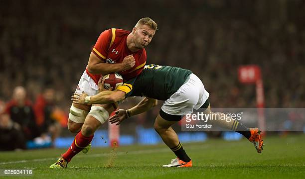 Springboks player Faf de Klerk puts in a big tackle on Ross Moriarty of Wales during the International match between Wales and South Africa at...