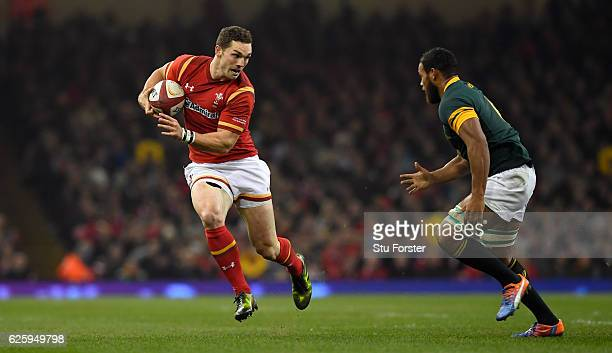 Springboks player Nizaam Carr looks on as George North of Wales races past during the International match between Wales and South Africa at...