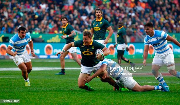 Springboks tight head prop forward Coenraad Oosthuizen is tackled during the International Rugby Test match between Argentina and South Africa at The...