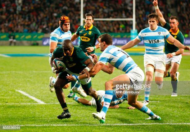 Springboks winger Raymond Rhule breaks through the Argentinian defence during the International Rugby Championship Test match between Argentina and...