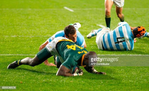 Springboks winger Raymond Rhule scores a try during the International Rugby Championship Test match between Argentina and South Africa at The Nelson...