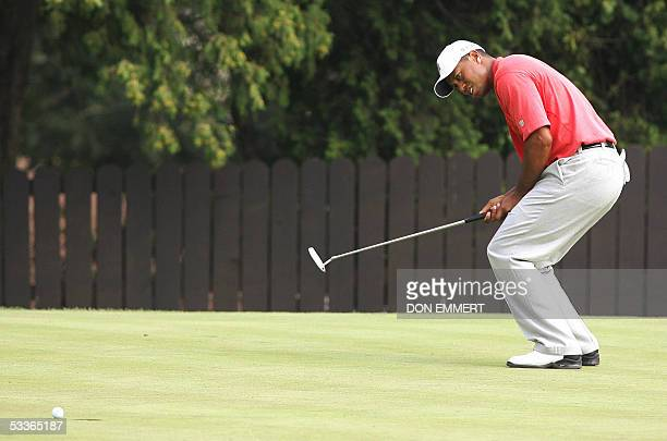 Tiger woods reacts as he just misses his putt on the 7th green at Baltusrol Golf Club during the second round of the 87th PGA Championship 12 August...
