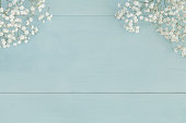 Light blue wood with baby's breath blossoms