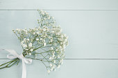 Spring bouquet on light blue wooden background