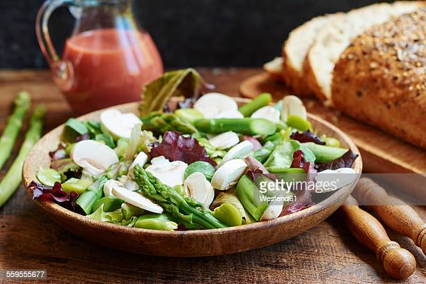 Springtime salad with asparagus, fava beans and mushrooms served with a rhubarb vinaigrette