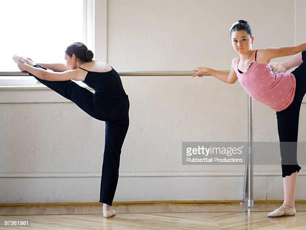 Springville, Utah, USA, Ballet dancers (10-11,12-13) stretching