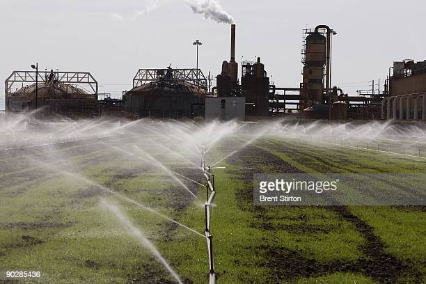 A sprinkler system sprays crops with water from an irrigation canal set in an agricultural area which traditionally uses water from the Colorado...