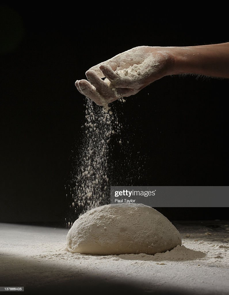 Sprinkling Flour on Dough : Stock Photo