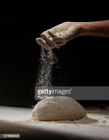 Sprinkling Flour on Dough