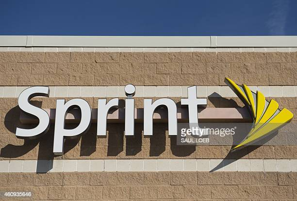 A Sprint cell phone company logo is seen on a store in New Carrollton Maryland December 31 2014 AFP PHOTO / SAUL LOEB