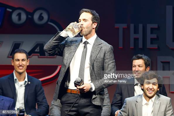 Sprint Cup Champion Jimmie Johnson drinks out of a Patron Silver Tequila bottle during the NASCAR Sprint Cup Trophy during NASCAR After The Lap at...