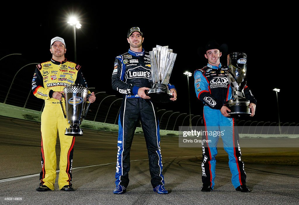 Sprint Cup Champion Jimmie Johnson (C), driver of the #48 Lowe's/Kobalt Tools Chevrolet, Nationwide Champion <a gi-track='captionPersonalityLinkClicked' href=/galleries/search?phrase=Austin+Dillon&family=editorial&specificpeople=5075945 ng-click='$event.stopPropagation()'>Austin Dillon</a> (R), driver of the #3 AdvoCare Chevrolet, and Camping World Truck Series Champion <a gi-track='captionPersonalityLinkClicked' href=/galleries/search?phrase=Matt+Crafton&family=editorial&specificpeople=561821 ng-click='$event.stopPropagation()'>Matt Crafton</a> (L), driver of the #88 Ideal Door / Menards Toyota, pose with their Series Championship Trophies after the NASCAR Sprint Cup Series Ford EcoBoost 400 at Homestead-Miami Speedway on November 17, 2013 in Homestead, Florida.