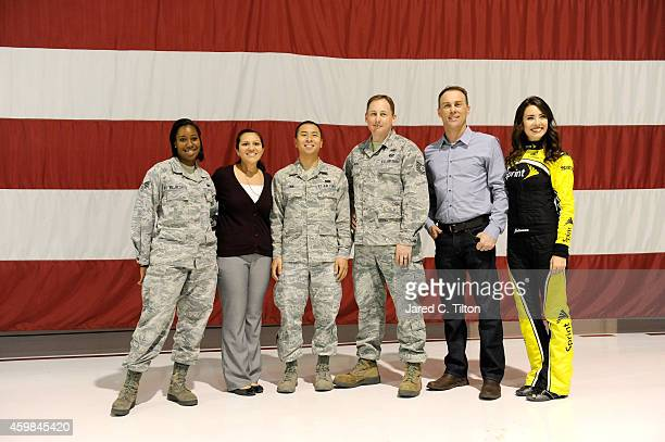 Sprint Cup Champion Kevin Harvick poses with Miss Sprint Cup Julianna White and members of the United States Air Force at Nellis Air Force Base on...