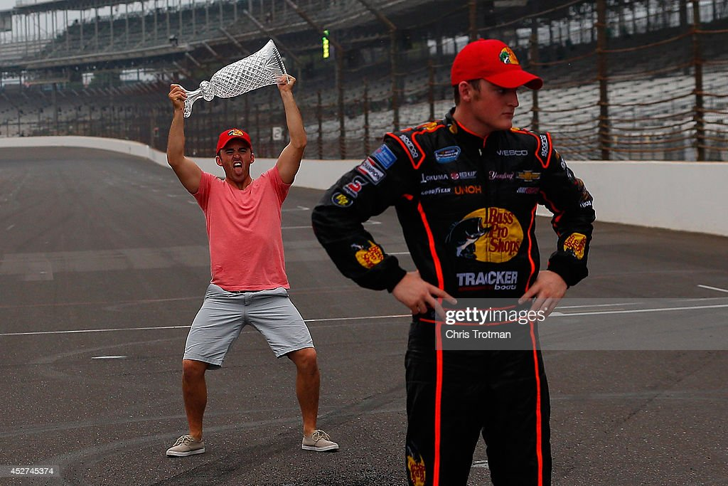 Sprint Cup driver Austin Dillon left holds the trophy won by brother Ty Dillon driver of the Bass Pro Shops Chevrolet after the NASCAR Nationwide...