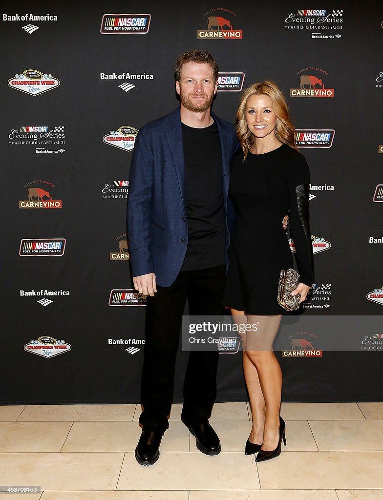 Sprint Cup driver <a gi-track='captionPersonalityLinkClicked' href=/galleries/search?phrase=Dale+Earnhardt+Jr.&family=editorial&specificpeople=171293 ng-click='$event.stopPropagation()'>Dale Earnhardt Jr.</a> and girlfriend Amy Reimann pose for a picture at the NASCAR Evening Series Presented by Bank of America at Carnevino at The Palazzo Las Vegas on December 4, 2013 in Las Vegas, Nevada.